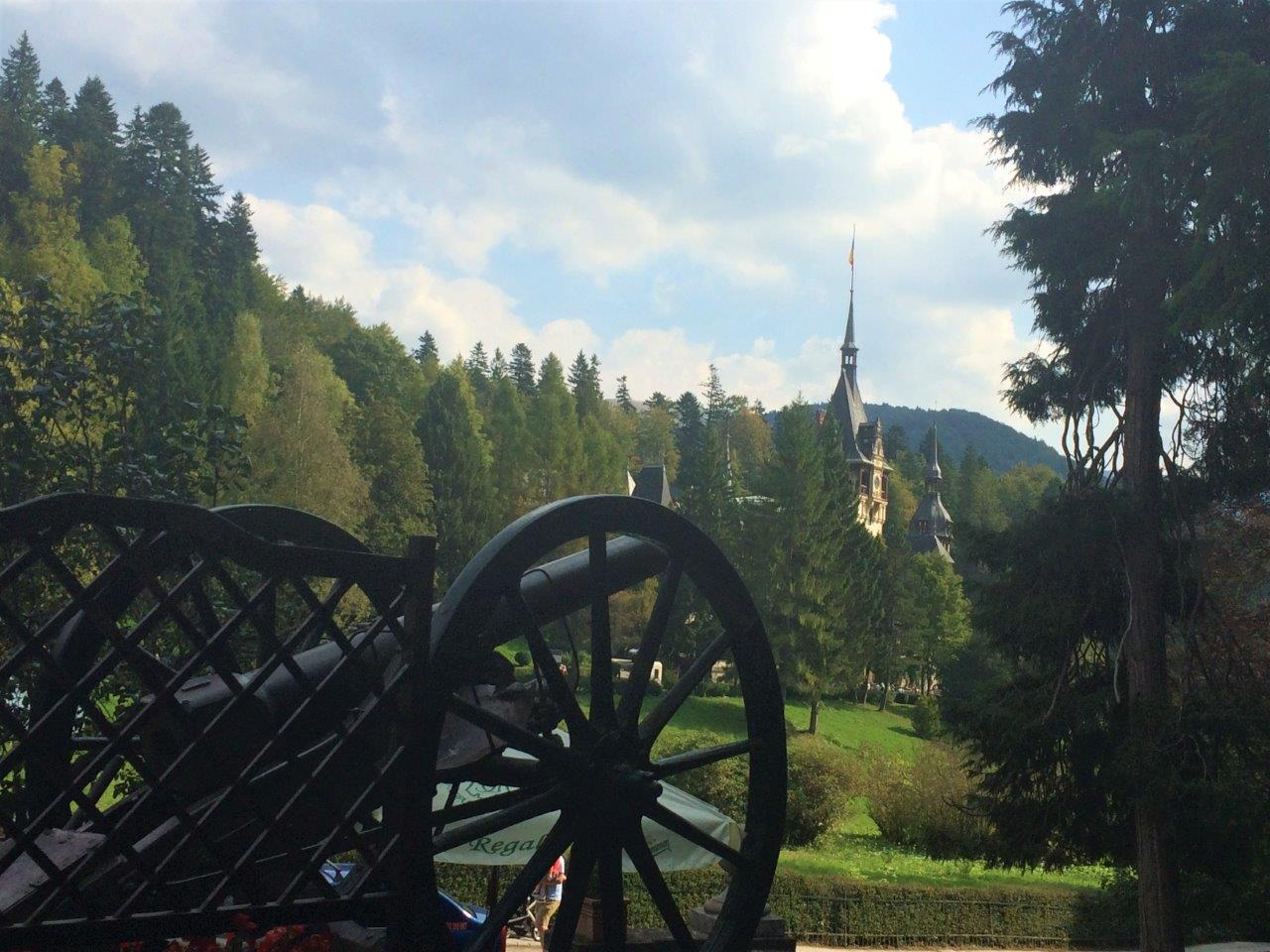 Peles Castle with a cannon in front of it