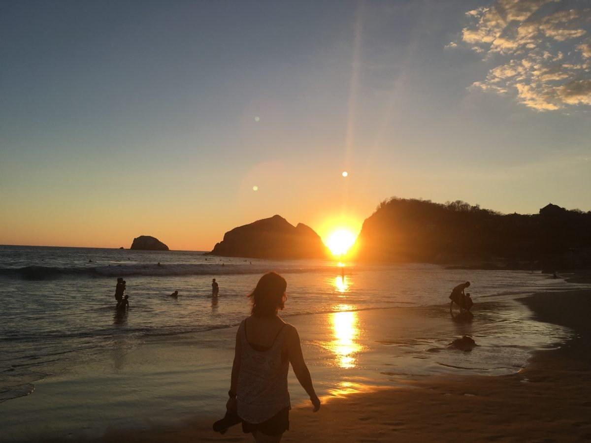 Walking down the beach at sunset in Zipolite