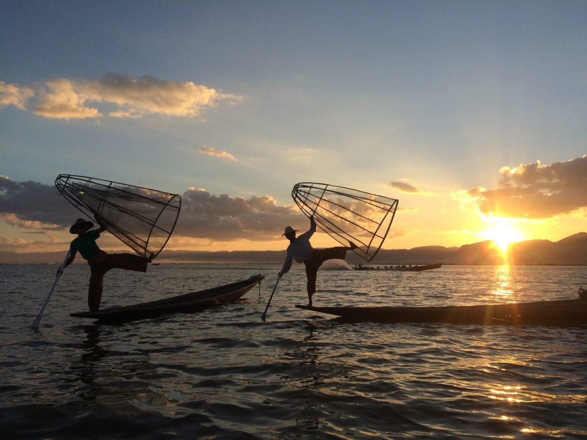 Fishermen at sunset on Inle Lake in Myanmar