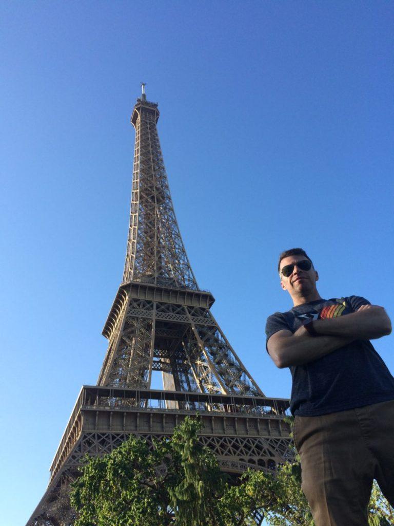 Man standing near Eiffel Tower