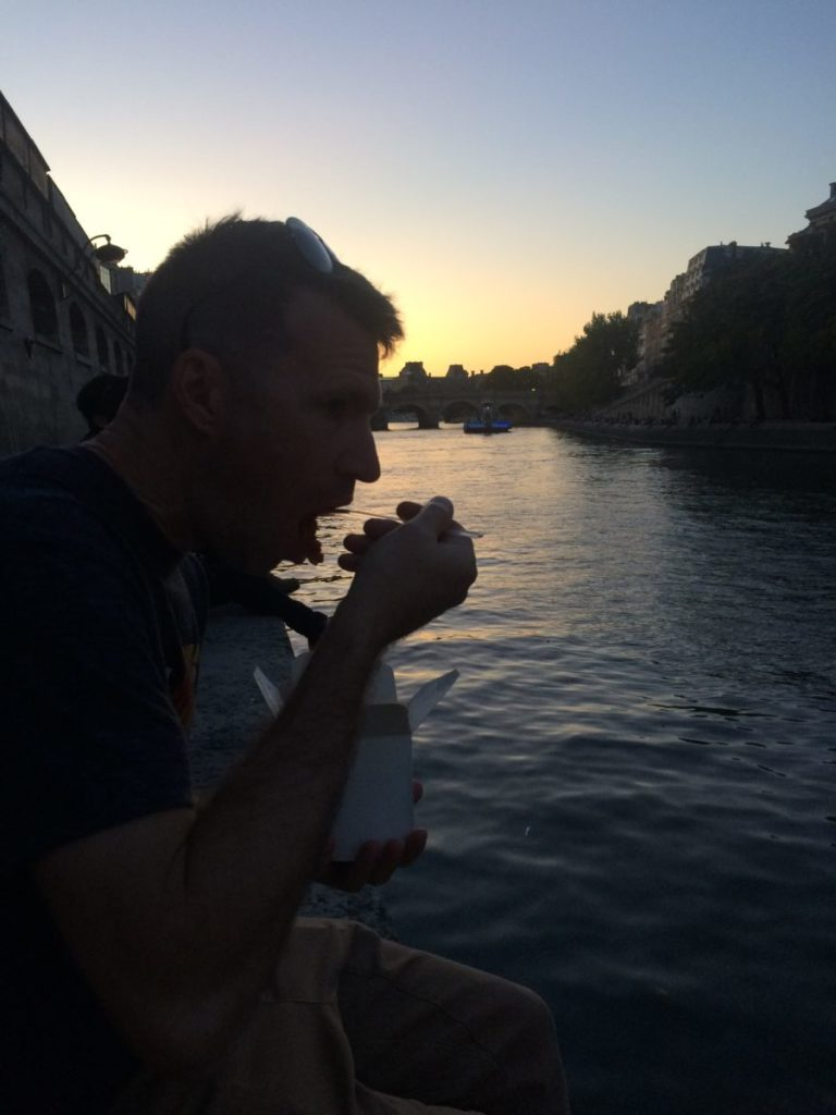 Man eating on the River Seine in Paris