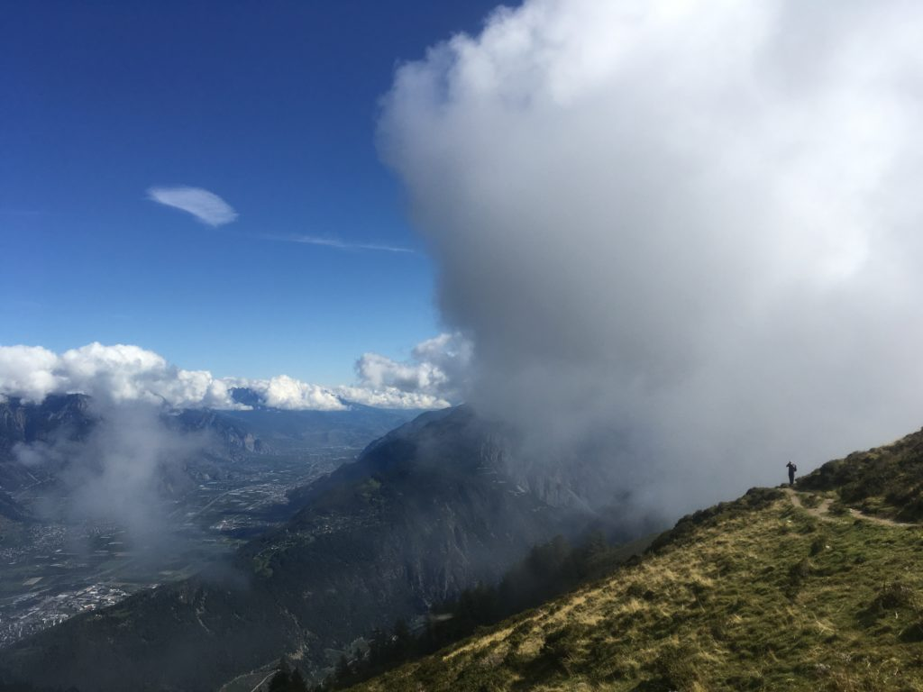 Man hiking in the clouds