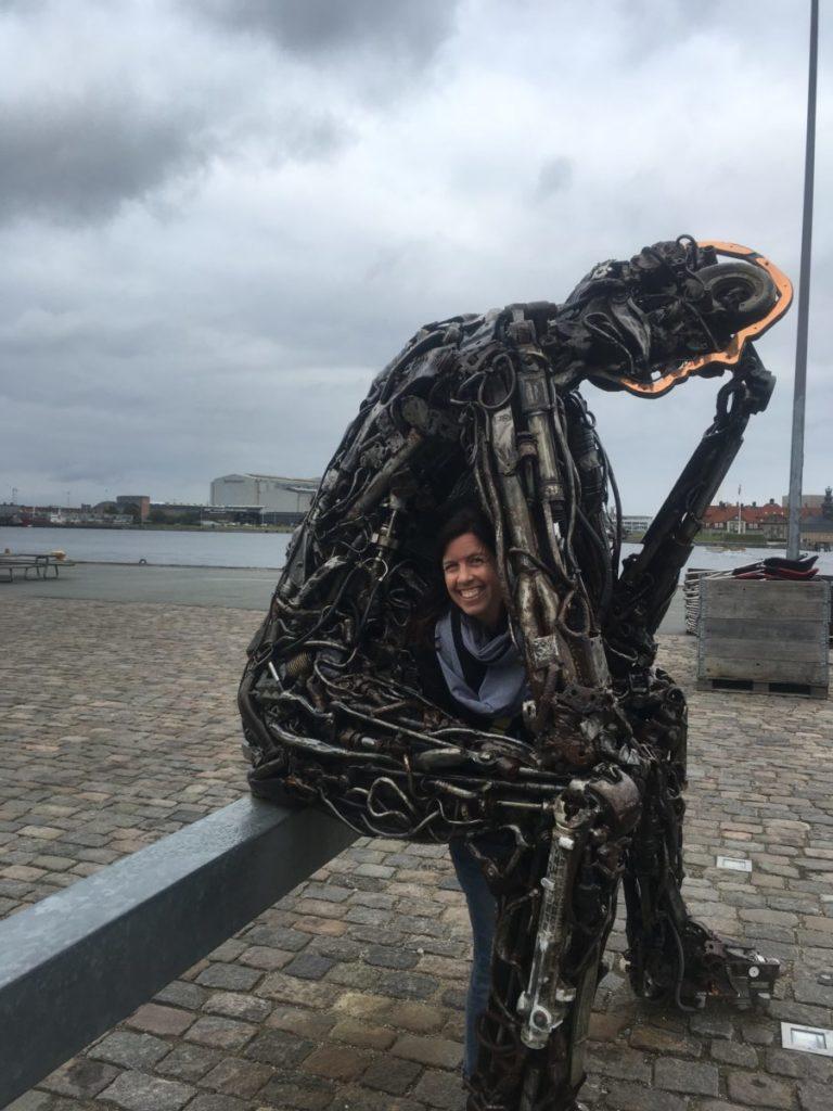 Woman in Thinker statue in Copenhagen