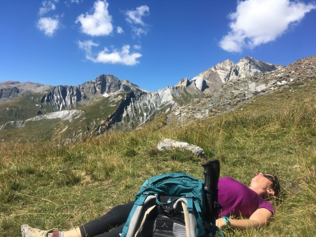 Female hiker resting in Italian Alps
