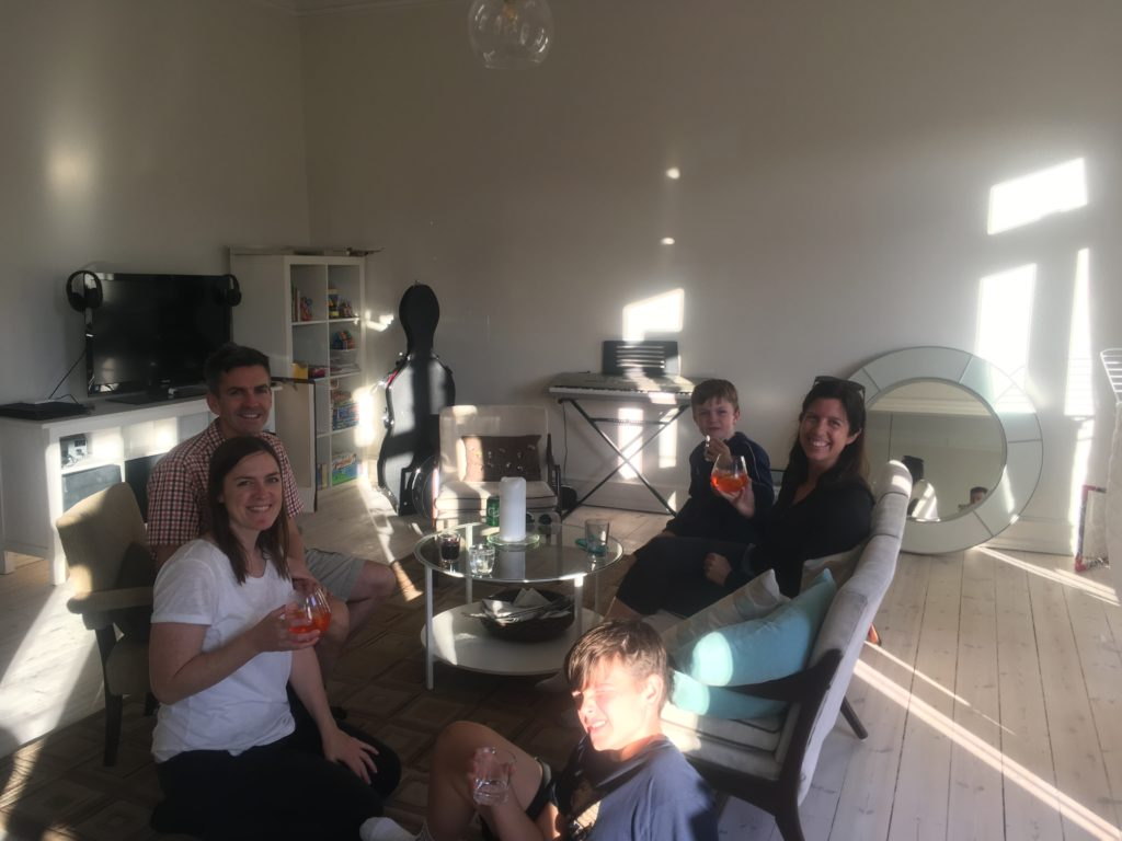 Family drinking in living room