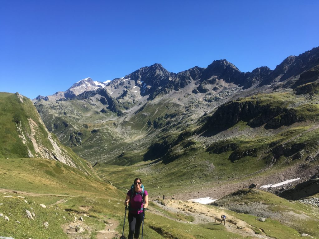 Woman hiking up to Col du Bonhomme