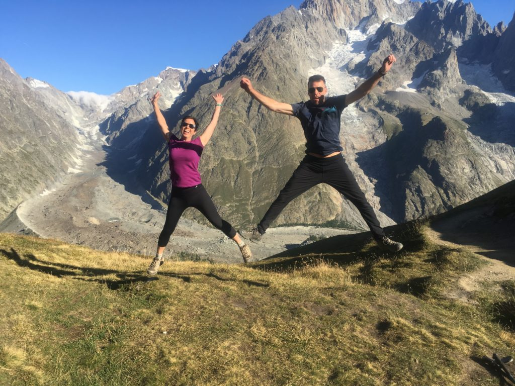 Couple jumping in the Alps