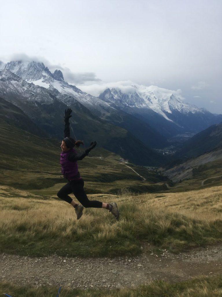 Woman jumping at Col de Balme on the Tour du Mont Blanc hike
