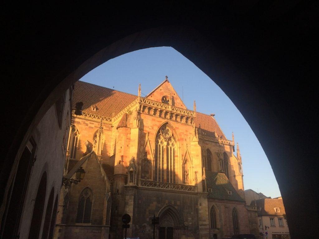 Church and arch in Colmar