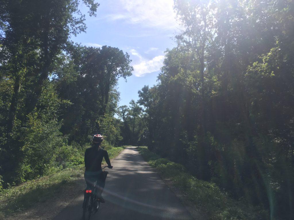 Woman biking in French countryside
