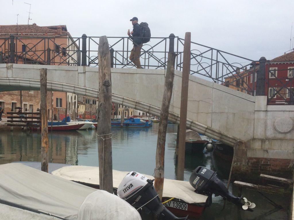 Man on a bridge on Murano, Italy
