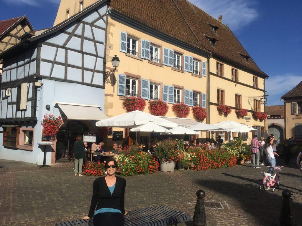 Woman in plaza in Eguisheim