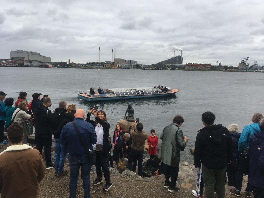 Crowd of people around Little Mermaid statue in Copenhagen