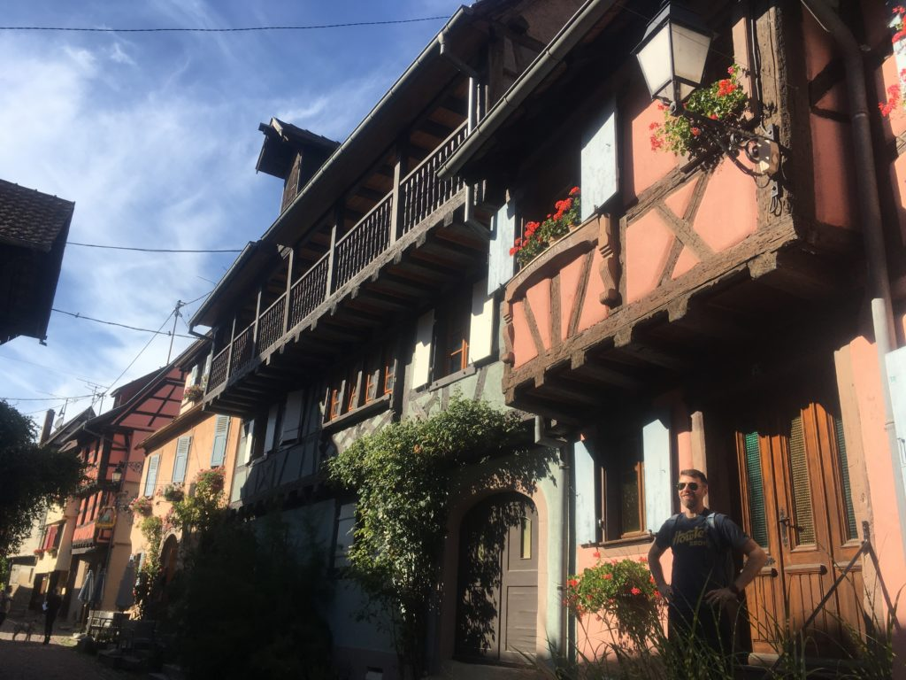 Man in front of house in Eguisheim