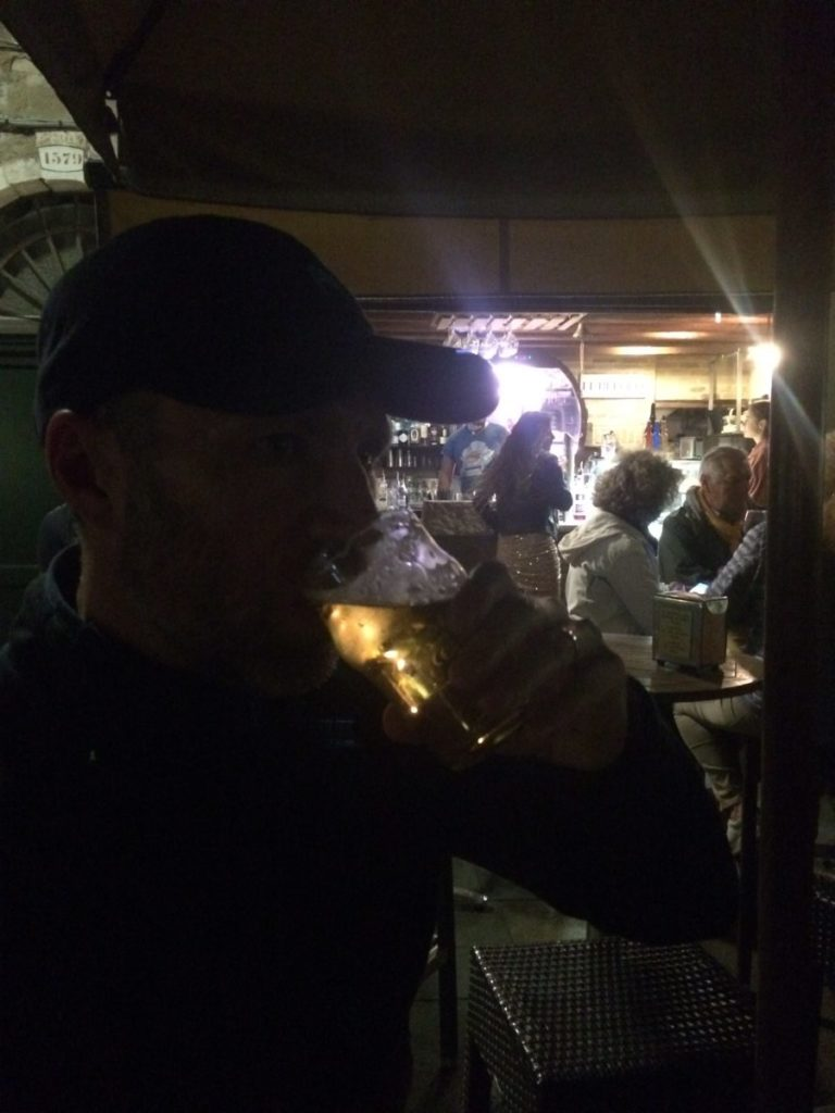 Man drinking beer at night in Venice