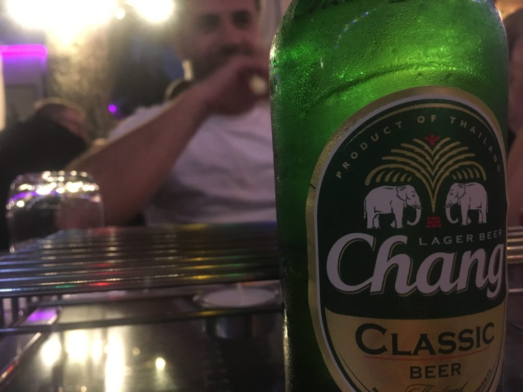 Australian drinking a Chang beer