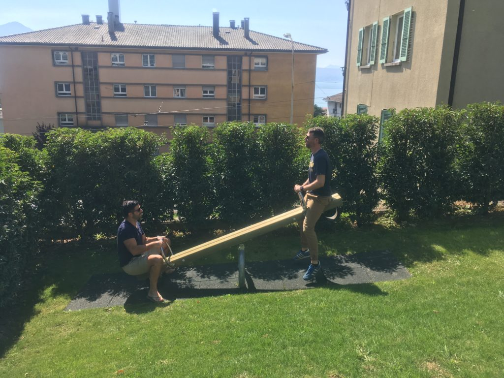 Two adult men on a teeter-totter