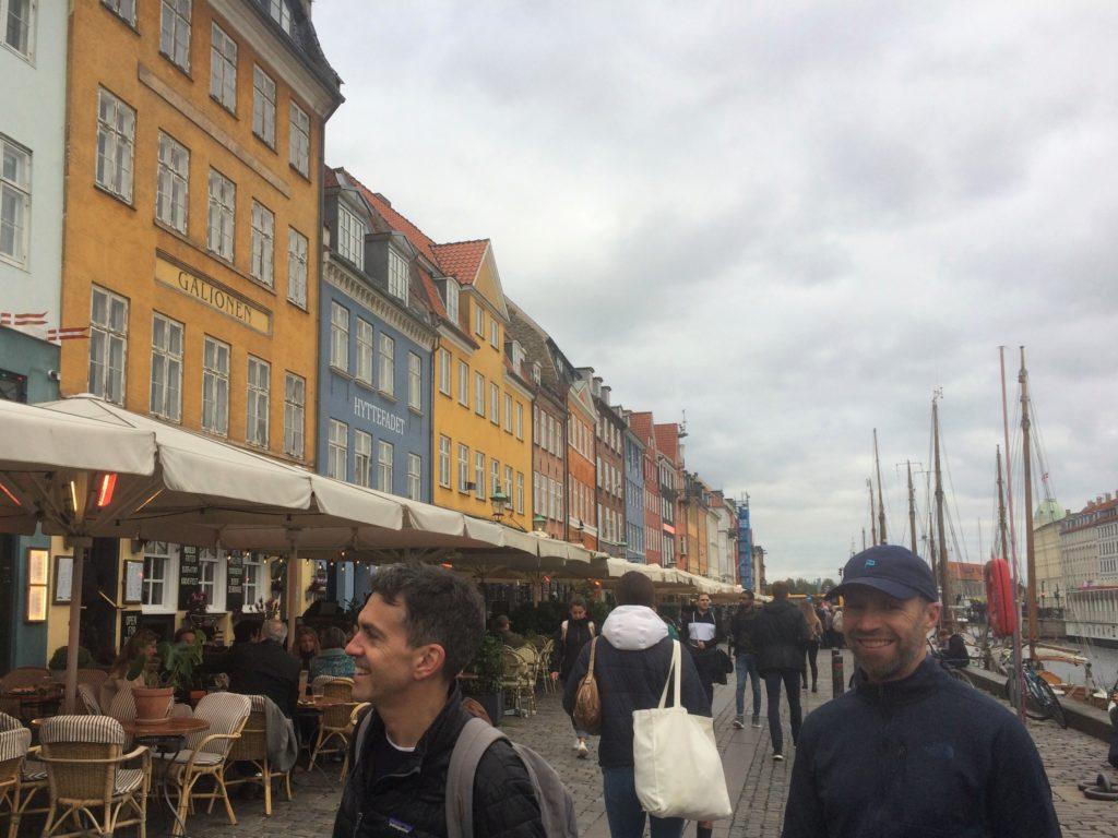 Two men walking in Nyhavn in Copenhagen