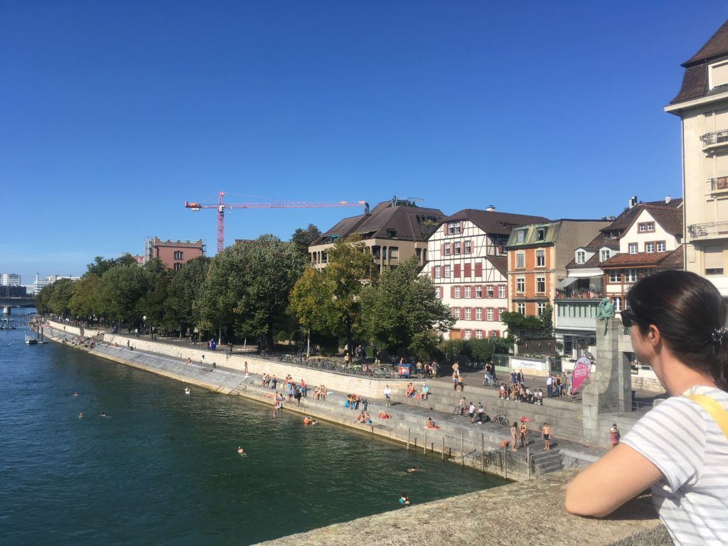 Woman overlooking the Rhine river in Basel