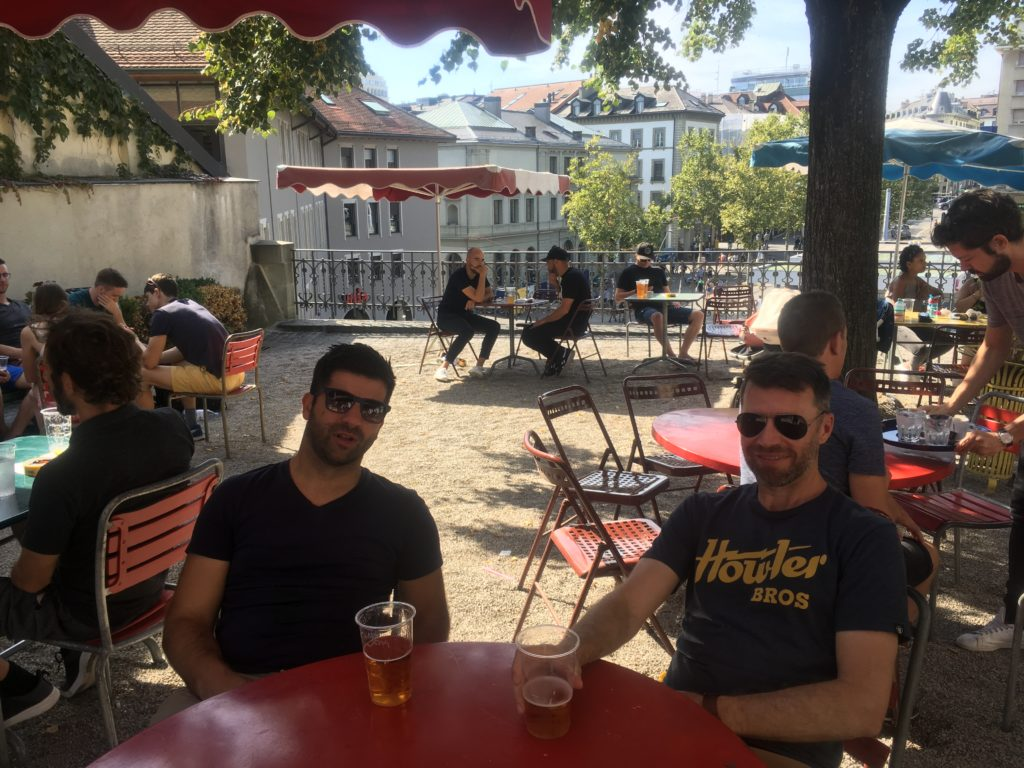 Men drinking at bar in Lausanne