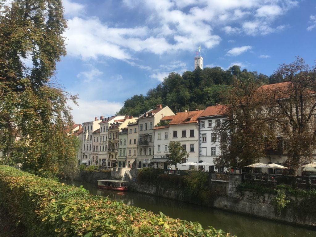 Houses along the Ljubljanica River and Ljubljana Castle