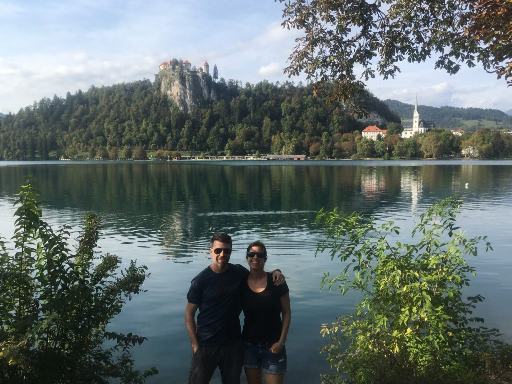 Couple standing in front of Lake Bled