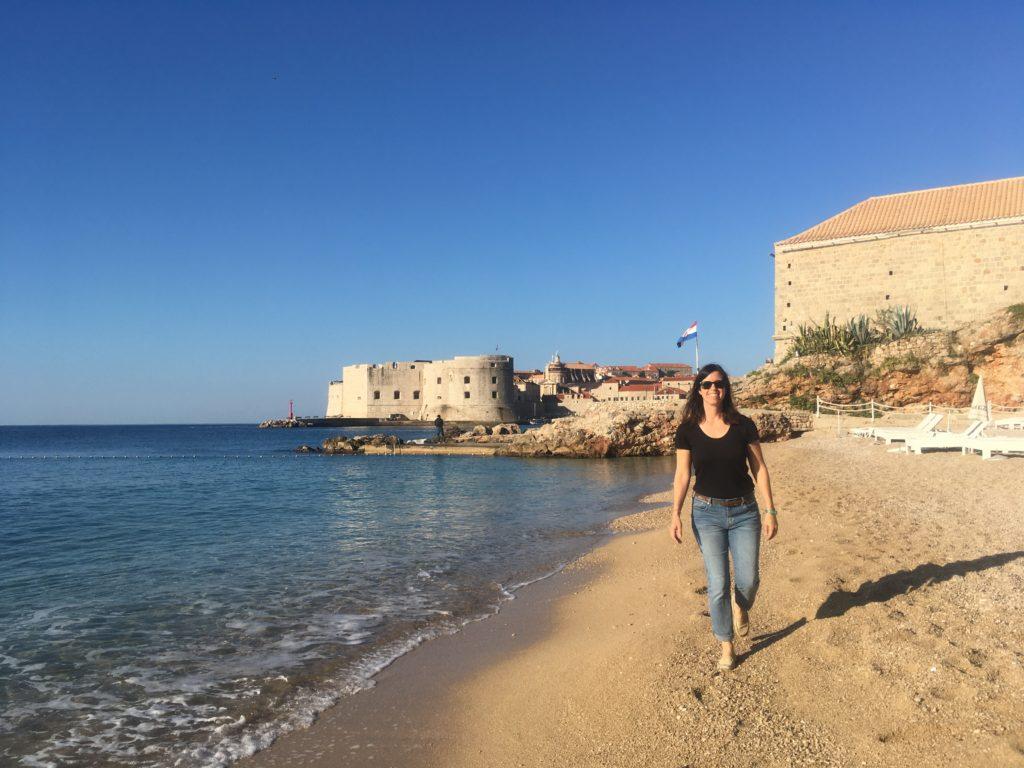 Woman walking on Banje Beach in Dubrovnik