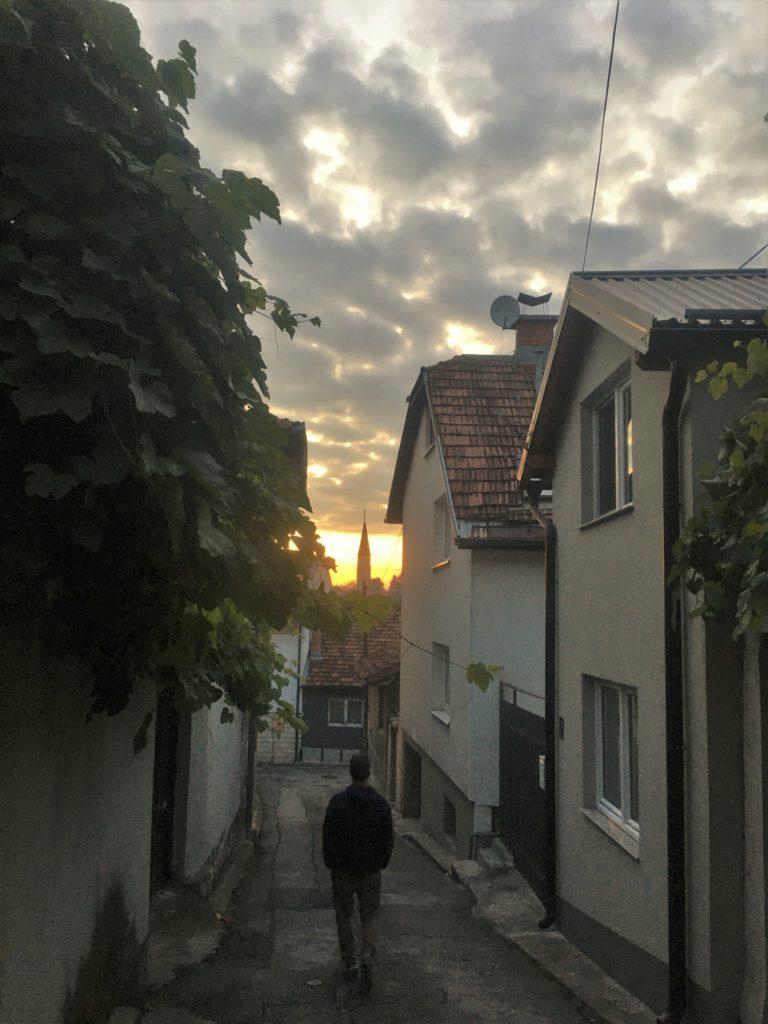 Man walking in back streets of Sarajevo