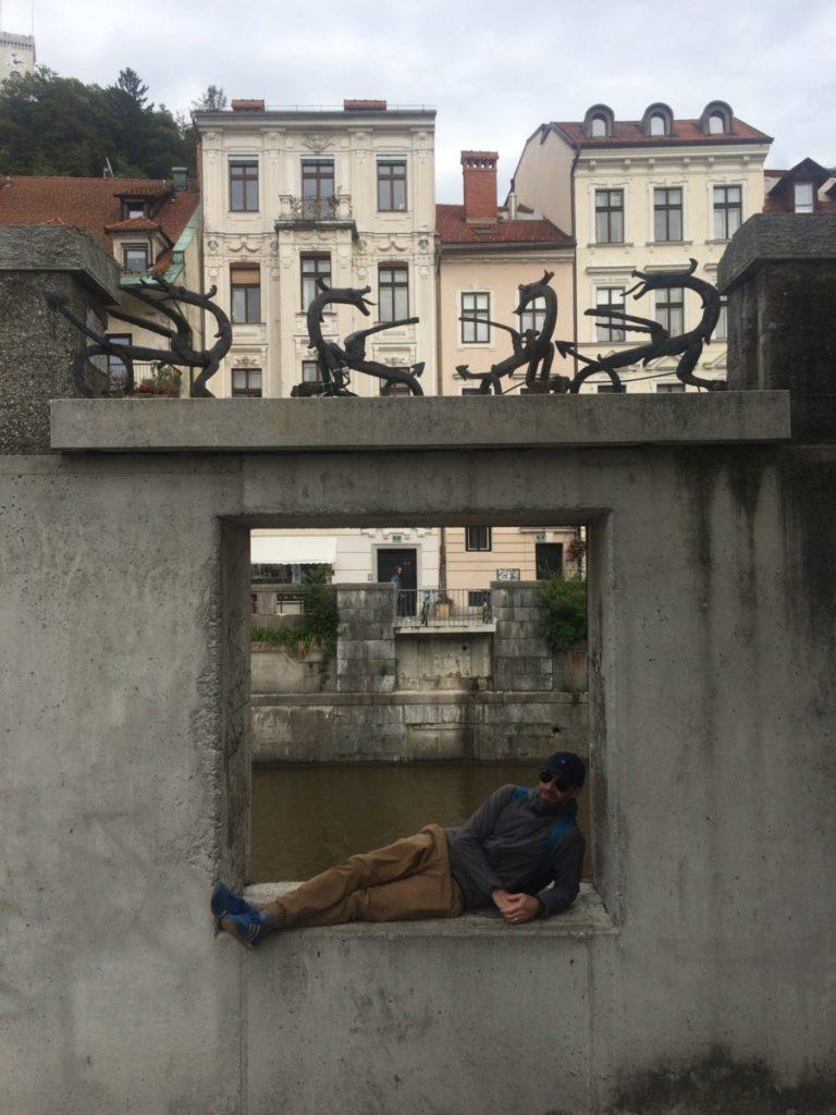 Man lying in window over Ljubljanica River