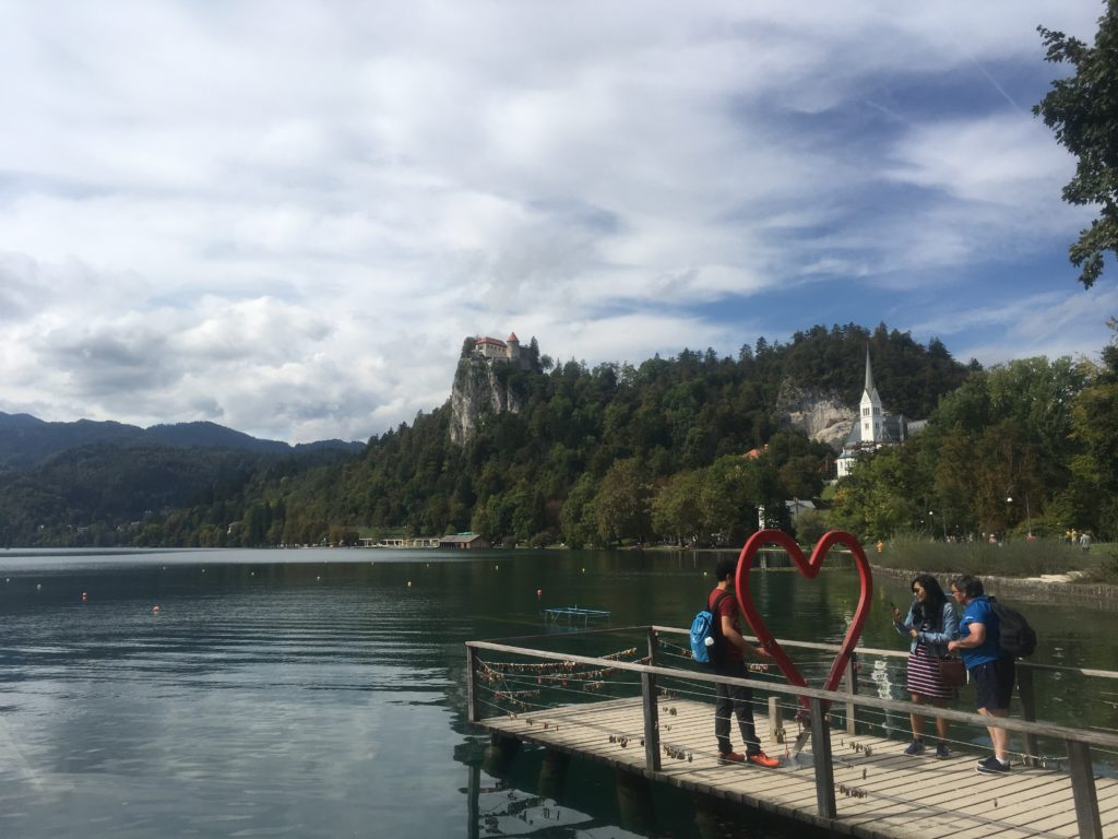 People taking photos at the Heart of Bled photo spot