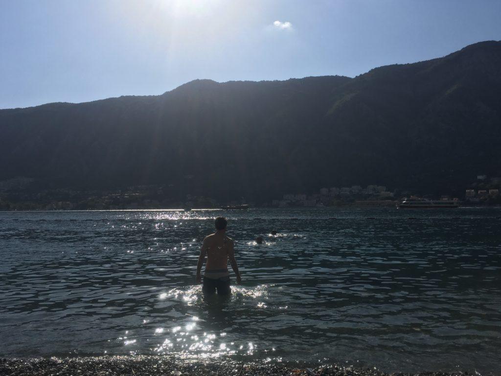 Man wading into Kotor Bay