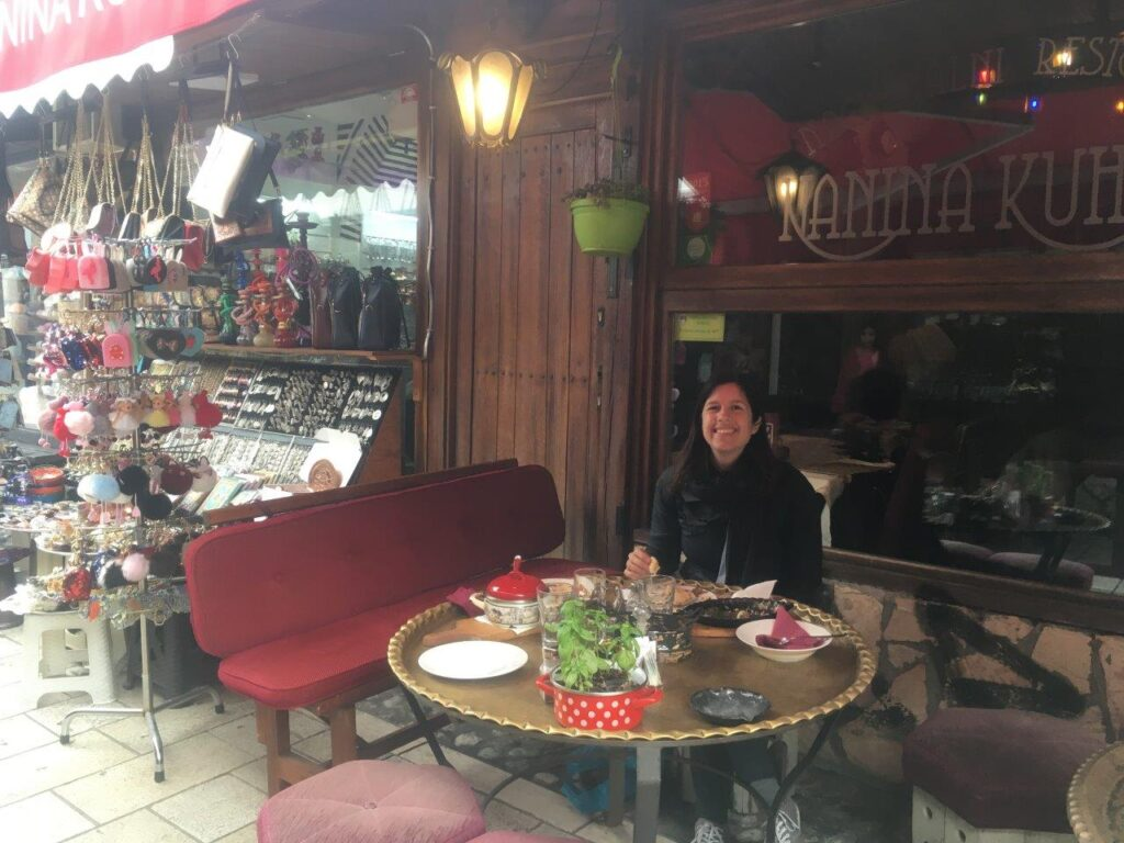 Girl at a table at a traditional restaurant
