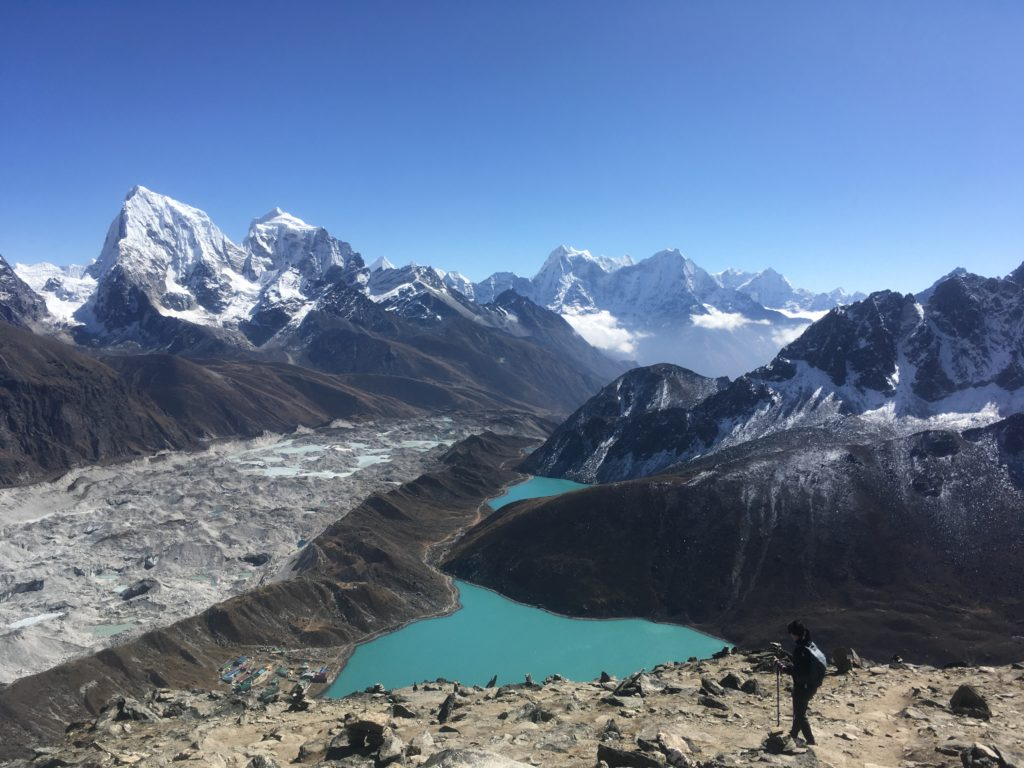 Woman hiking down to Gokyo Lake