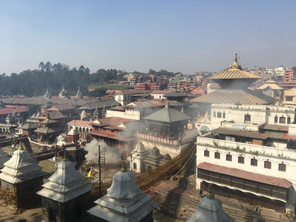 Body being burnt on a funeral ghat in Pashupatinath, Nepal