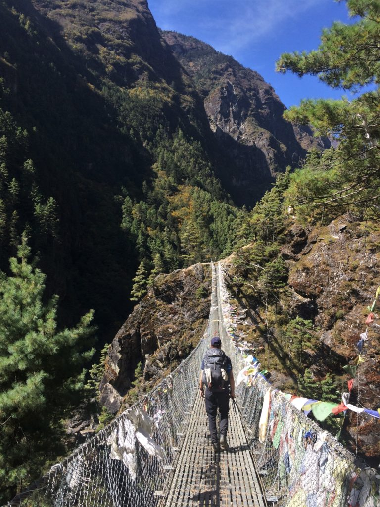 Man crossing swinging bridge in the Solu Khumbu region