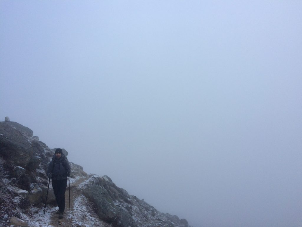 Man hiking in the fog