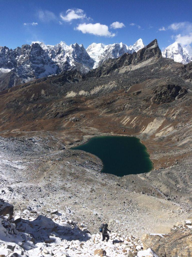 Man hiking up to Renjo La, Nepal