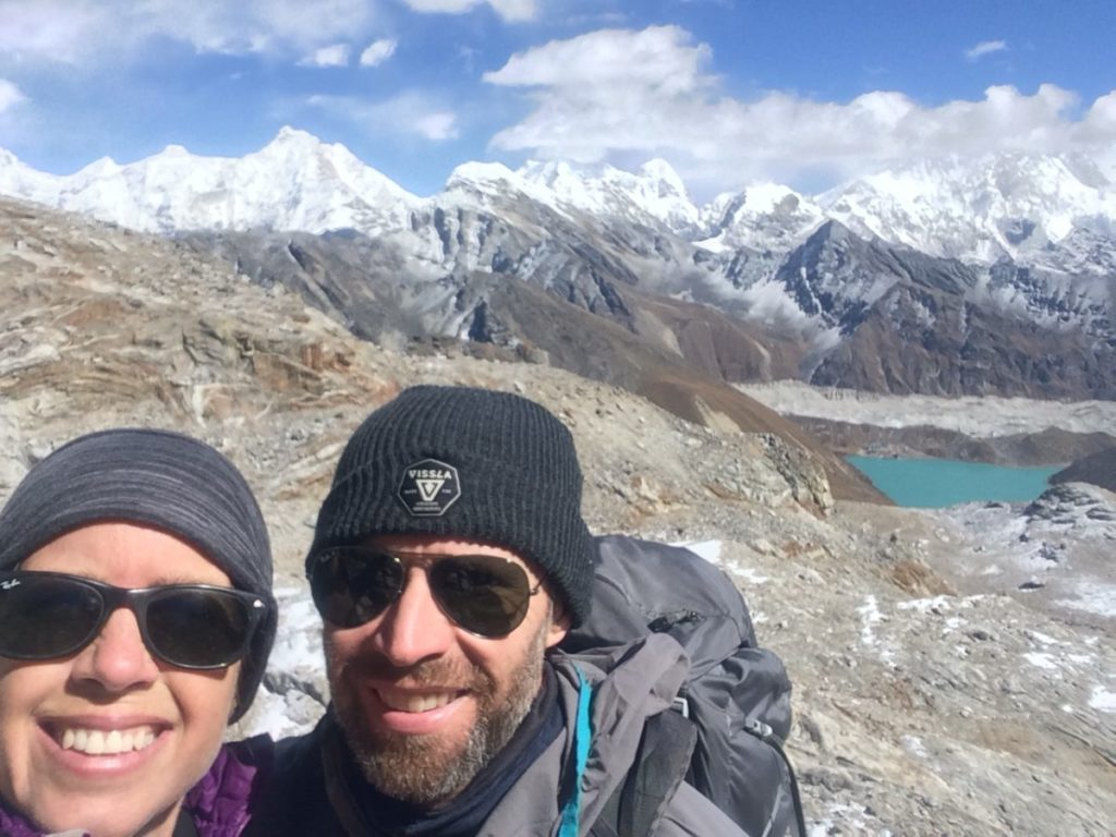 Couple on Renjo La with Gokyo Lake in the background