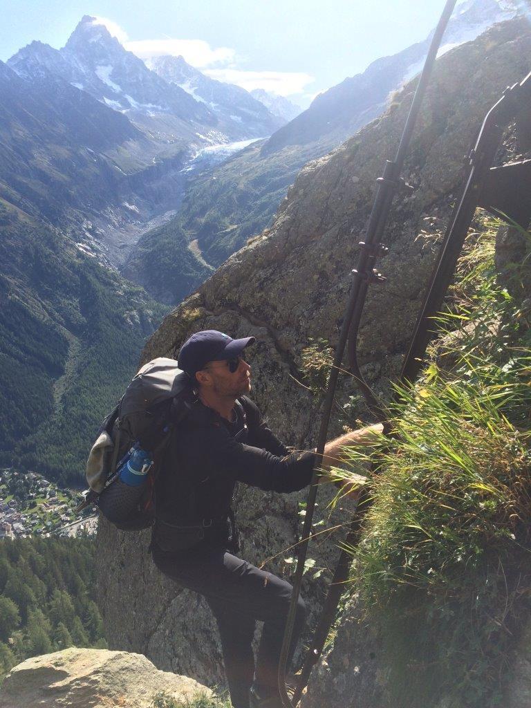Man climbing ladder on the Tour du Mont Blanc