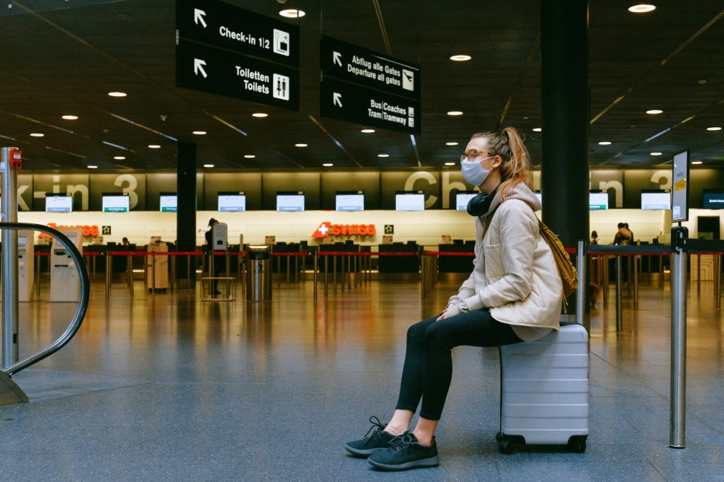 Woman in airport wearing protective mask