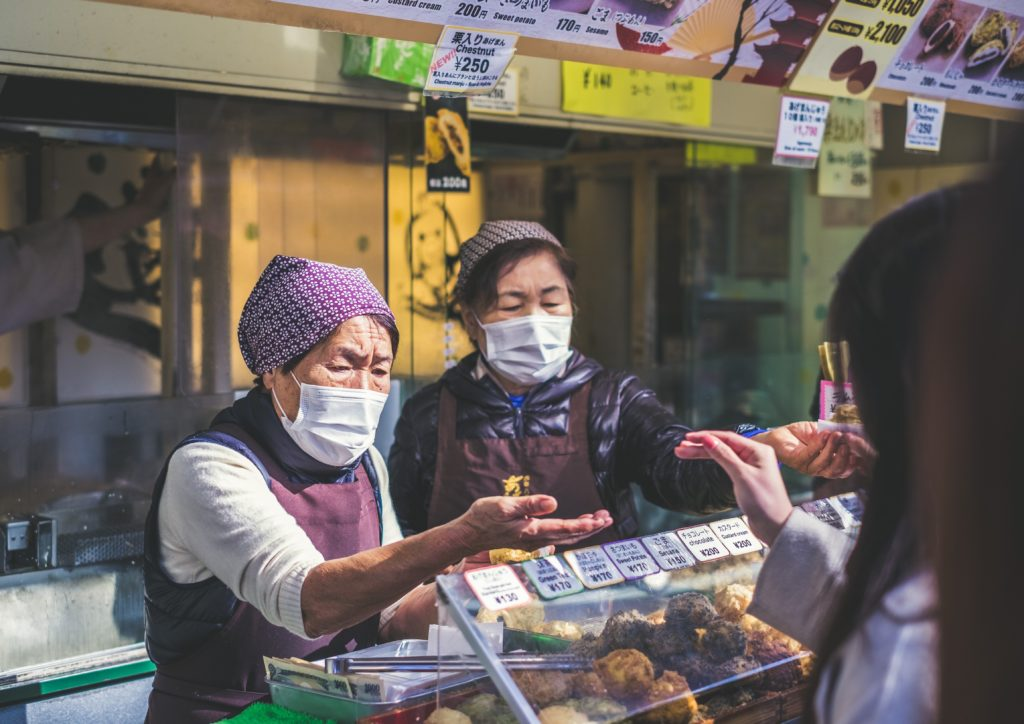 Asian shopkeepers wearing protective masks