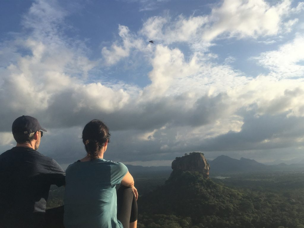 Couple watching Lion Rock at sunset