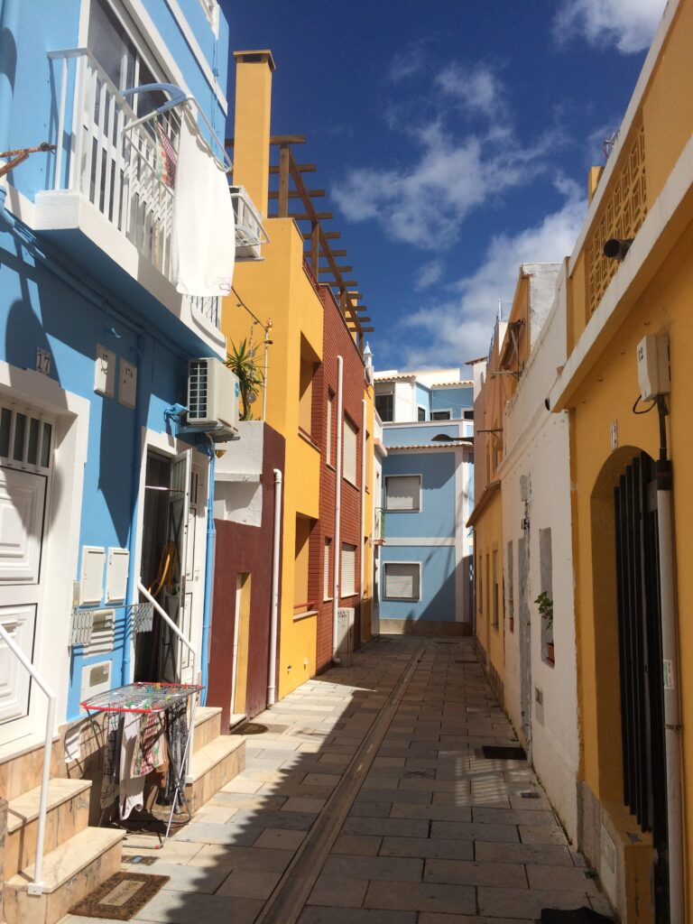 The narrow streetes with colourful houses on the old town on Armacao de Pera Algarve