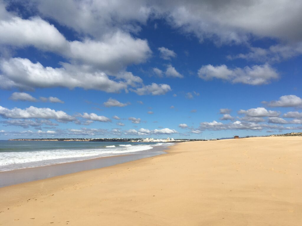 The long stretch of beach, ocean and sand towards Armacao de Pera Portugal