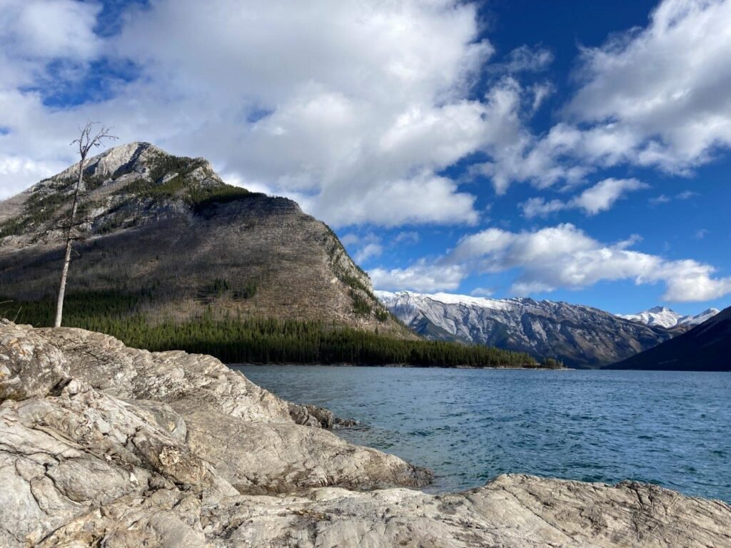 Lake with mountain in background on one of the best easy hikes Canmore offers