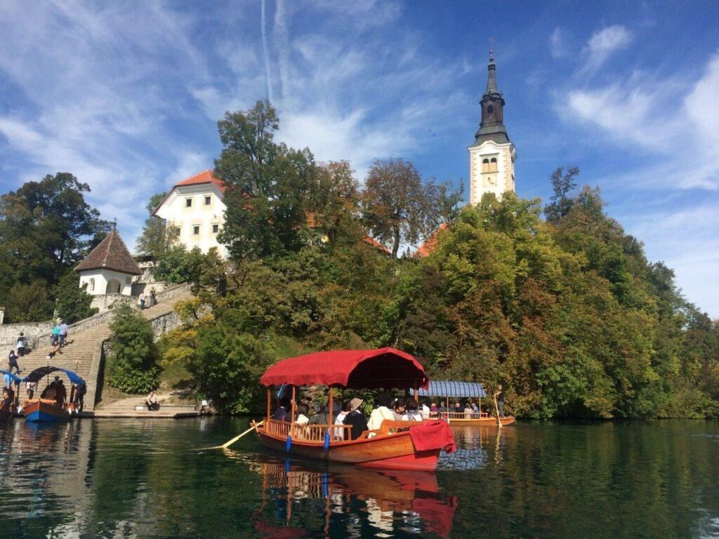 Tour group, who came from Ljubljana to Lake Bled, visiting Bled Island on a pletna