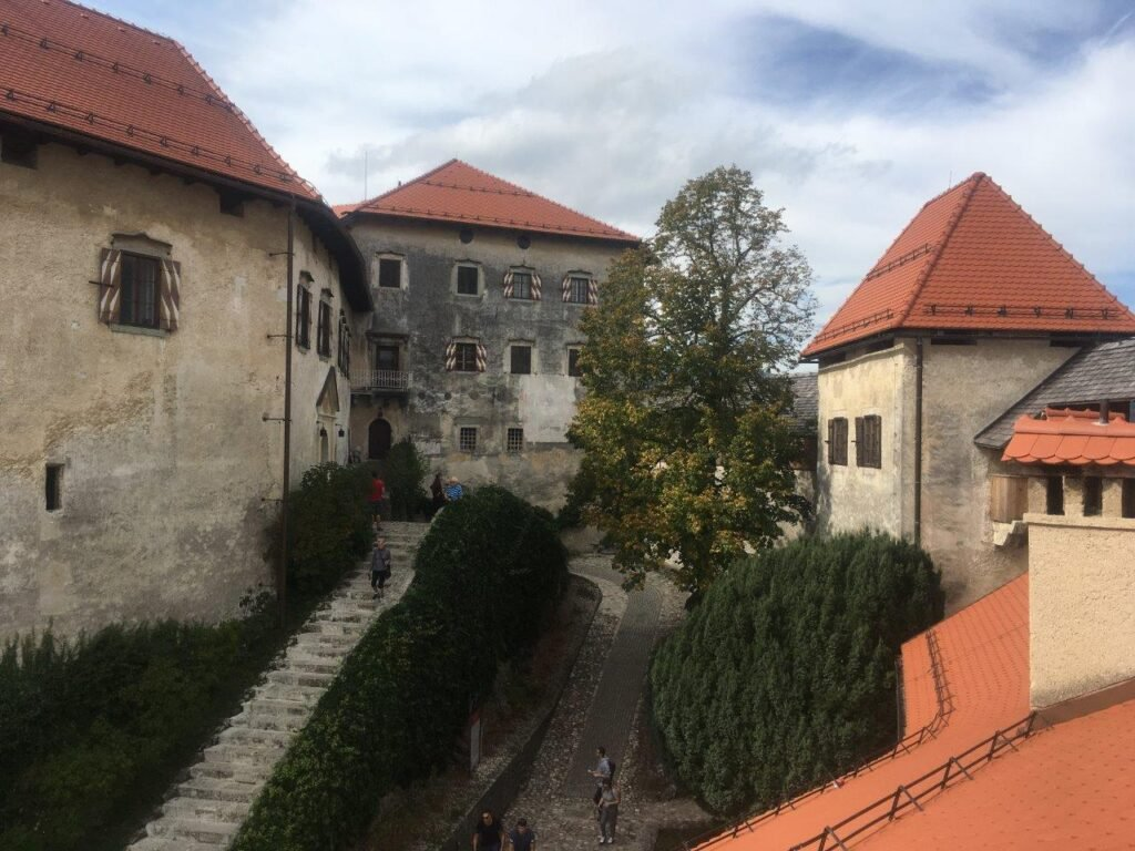 The Bled Castle buildings with red roofs