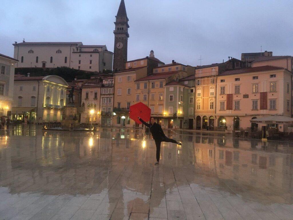 Woman with umbrella in Tartini Plaza, Piran Slovenia