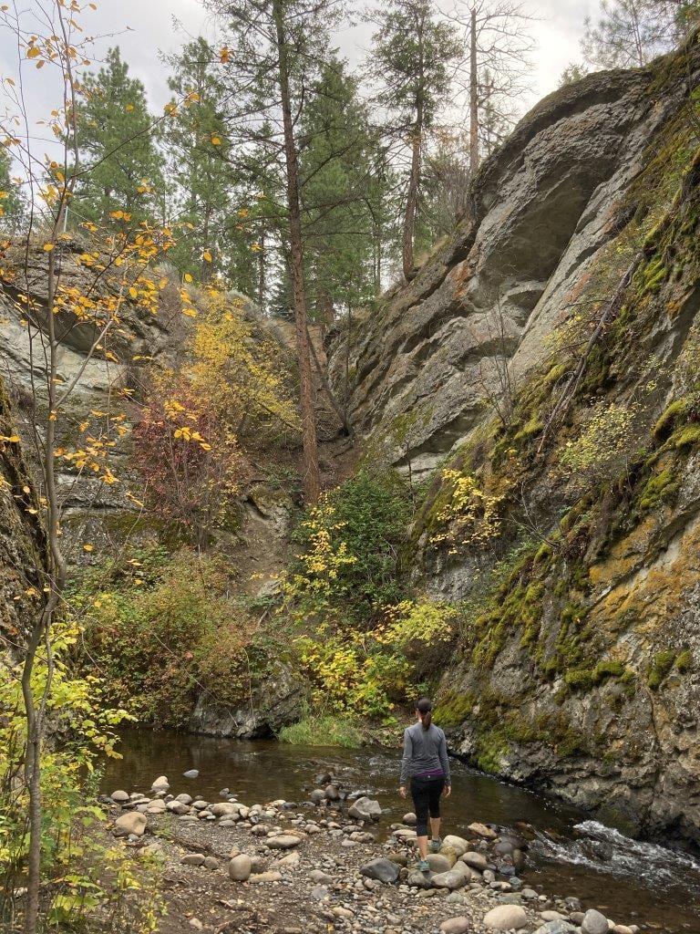 Woman by stream in Glen Canyon in West Kelowna