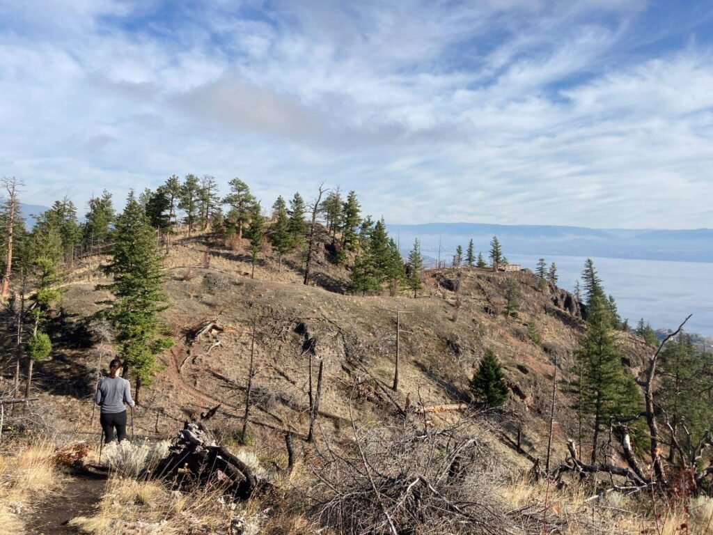 Woman hiking on Goat's Peak in West Kelowna
